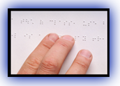 Photo of fingers touching a page written in Braille